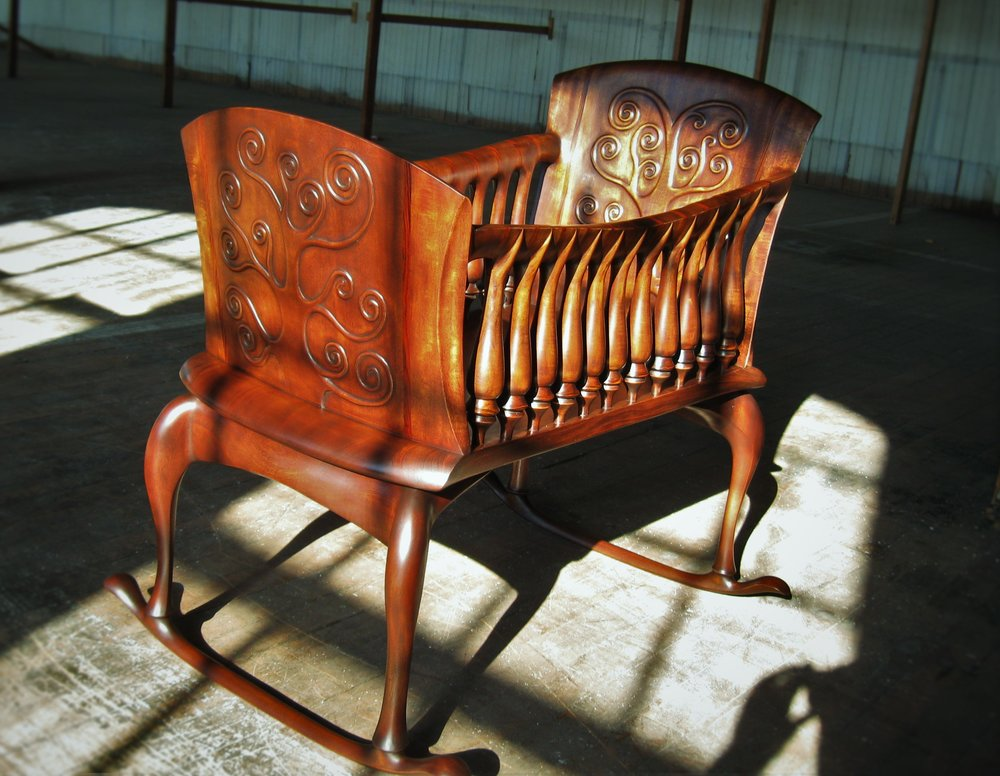 Lilly Cradle    Starting at $9,500   Shown in Dyed African Mahogany and Cocobolo