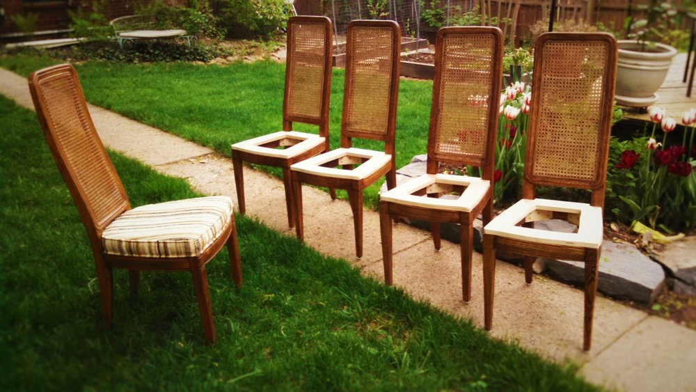 Reproduction Chairs     Shown in Stained Oak with Caned Backs.