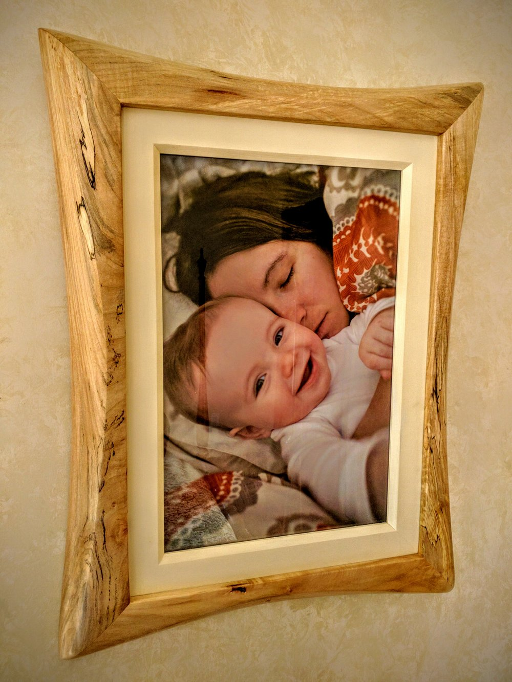 "Sculpted Frame    $950          Shown in Spalted Maple and Painted Poplar    Fits 12""x18"" Photo."