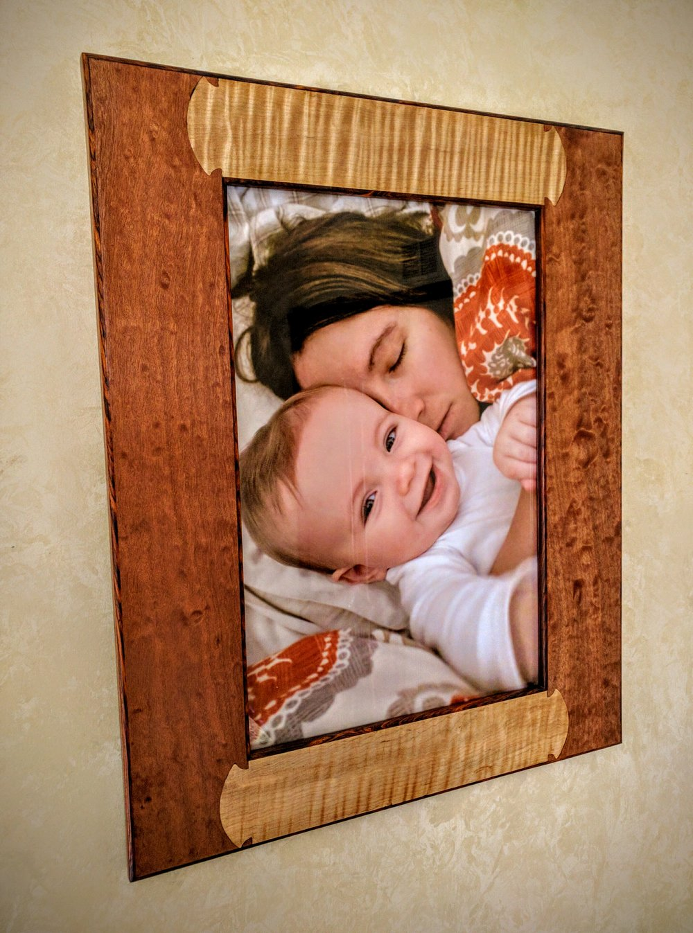 "Prox Frame #1   $1,250     Shown in Cocobolo, heavily figured Makore and Maple.   Fits 12""x18"" Photo."