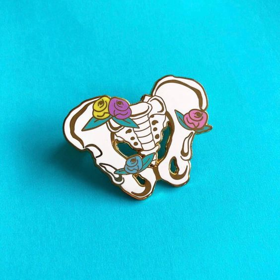 PELVIS PIN   Won't this sweet little pin be disarming on the lapel of a lab coat! Sweet little touches like these can go a long way… $13 by The Project