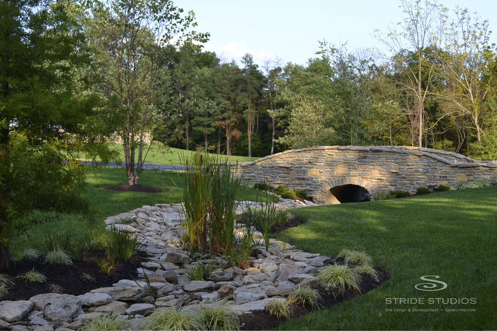 08-stride-studios-fieldstone-bridge-creek-swale.jpg