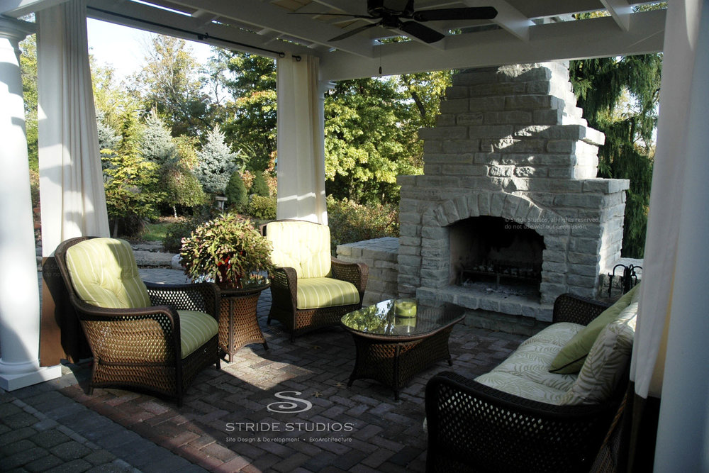 25-stride-studios-covered-terrace-fireplace-pergola.jpg