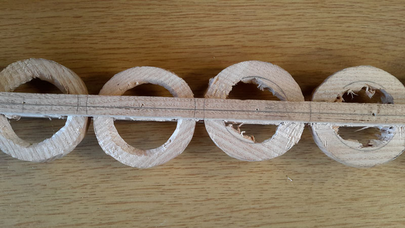 Using a fine saw blade to join the holes, the rings are formed and can be turned.