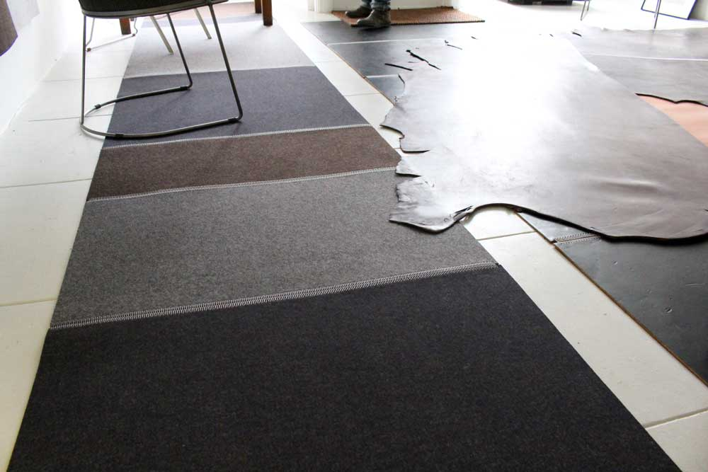 Left: Wool Felt Rug in Graphit, Asche & Trufflebraun, Right: Leather Flooring