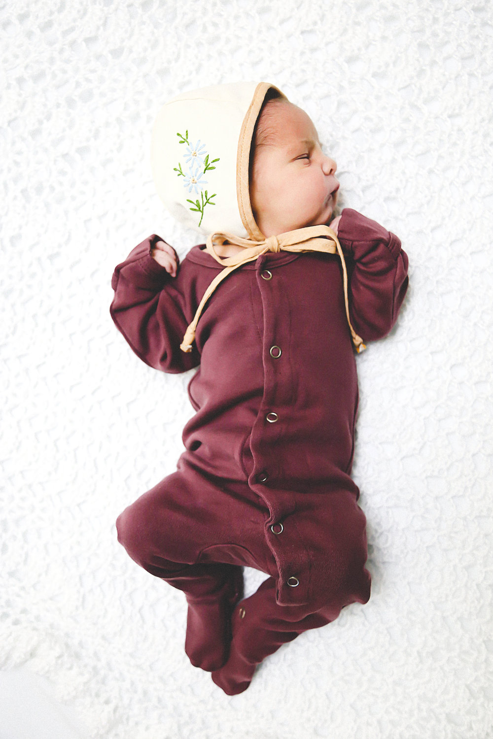 Newborn Christmas Baby in L'oved Baby Footed Overall in Eggplant