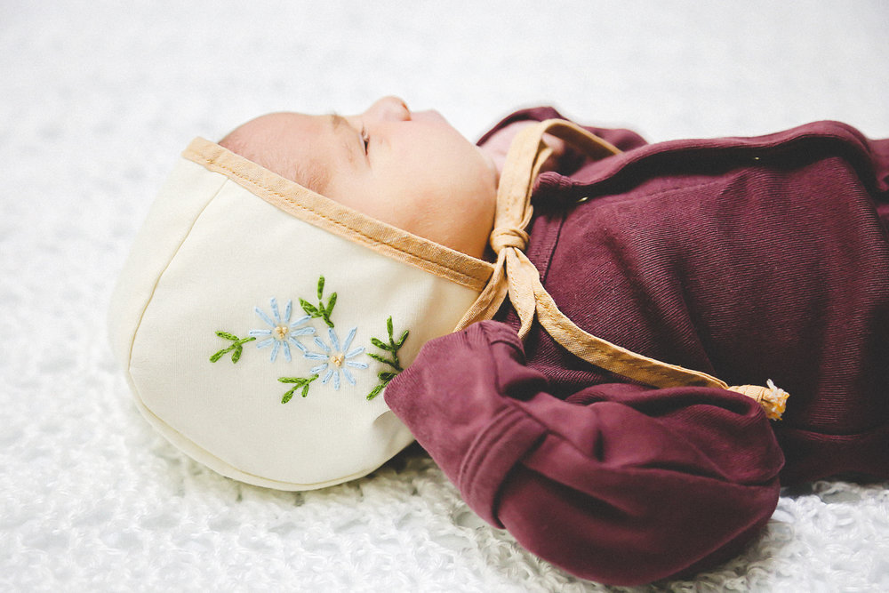 Newborn Baby in Handmade Sweet As April Bonnet