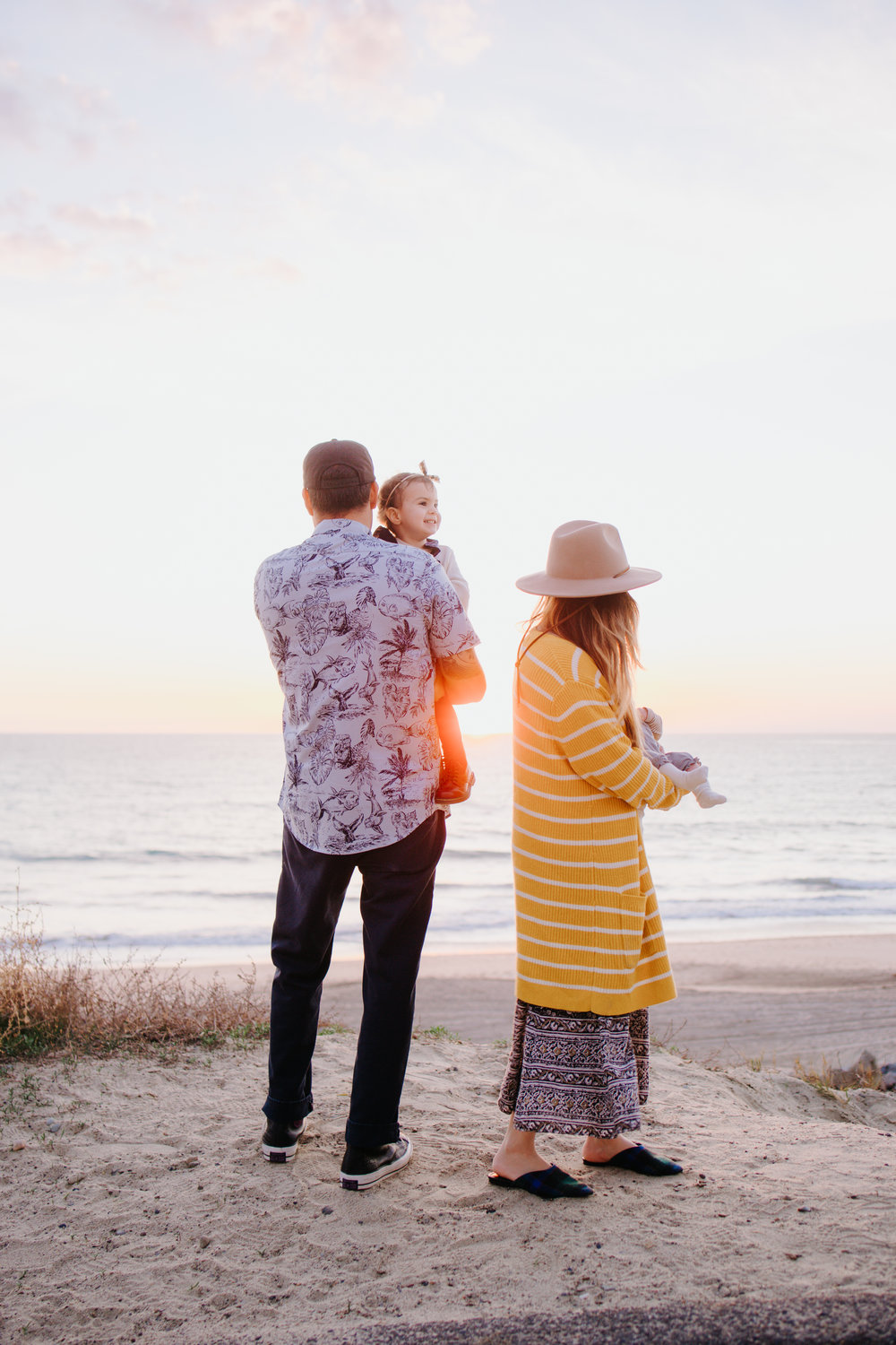 Young Family Standing on Clff at Sunset at San Clemente State Beach California