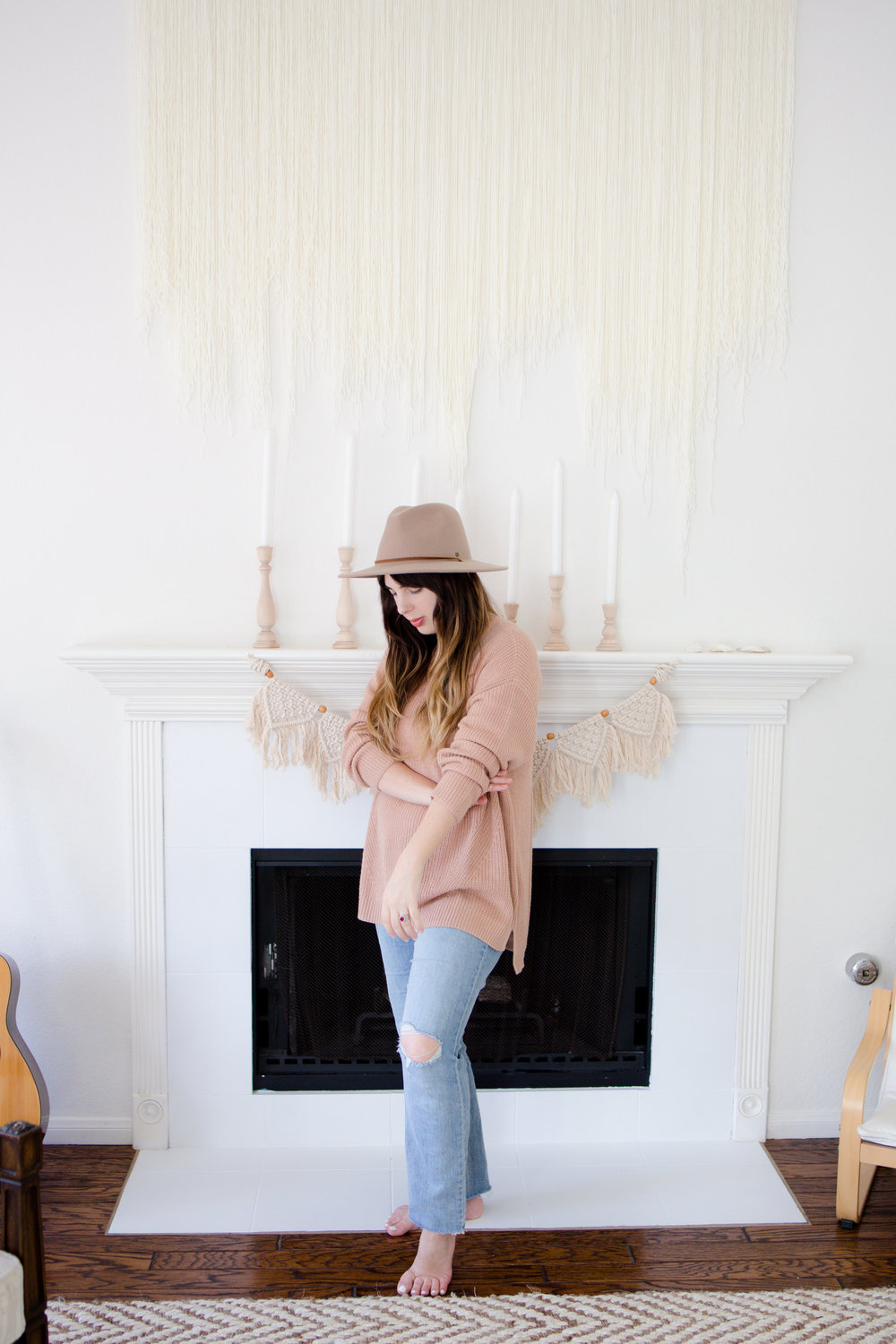 Girl in Oversized HM Sweater and Brixton Field Worker Hat in Front of Fireplace Urban Outfitters