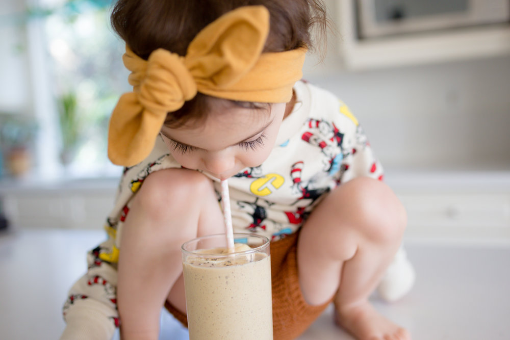Toddler Girl Drinking Vegan Peanut Butter Banana Protein Smoothie Smoothie