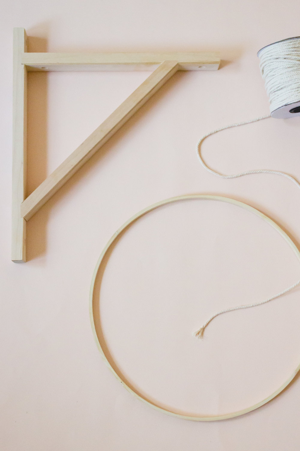 Ikea Valter Bracket, embroidery hoop, and macrame rope - used to make a diy tassel mobile for a boho nursery