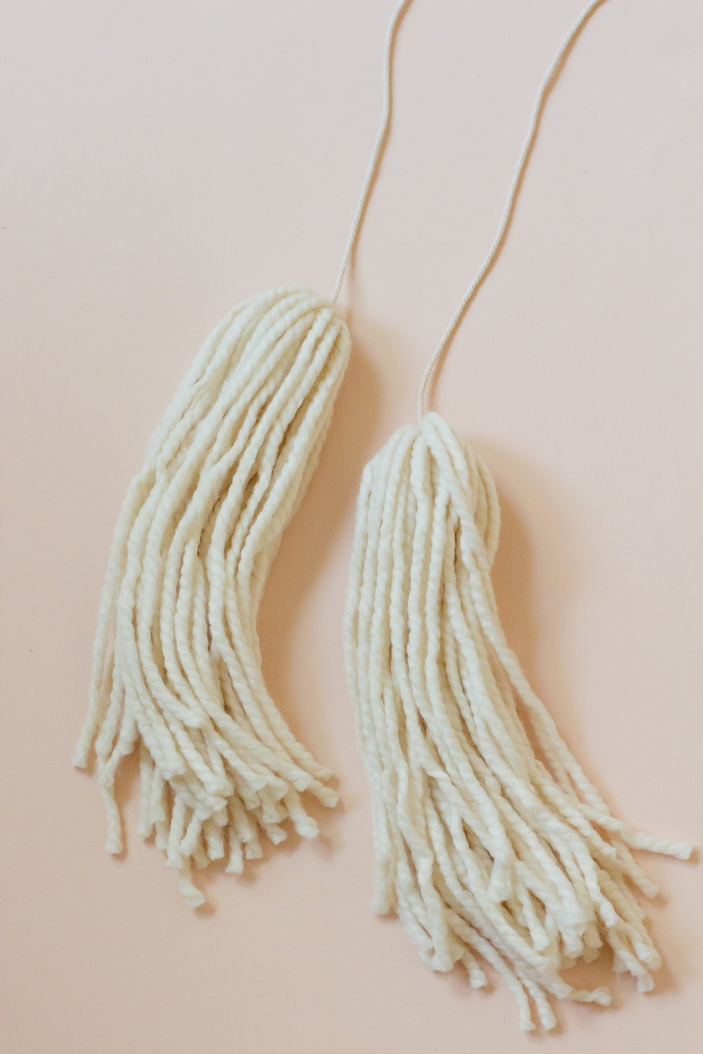 wool yarn tassels for a DIY boho tassel mobile for gender neutral minimalist nursery