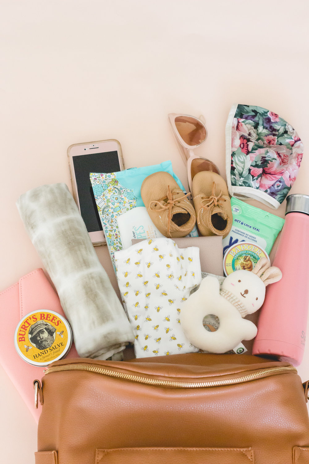 Flat Lay of Fawn Design Diaper Bag with Diaper Bag Essentials