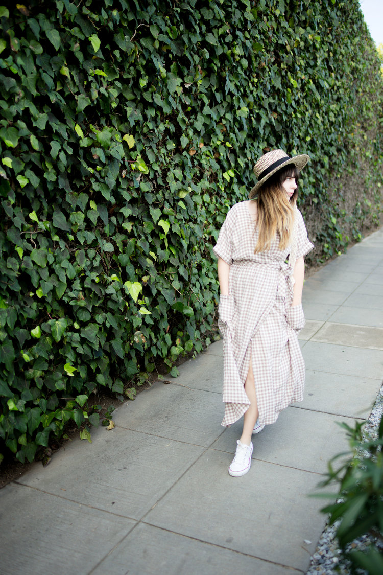 e652155a947 Streetstyle of Girl Wearing UO Gabrielle Linen Midi Wrap Dress and white  converse chuck Taylors