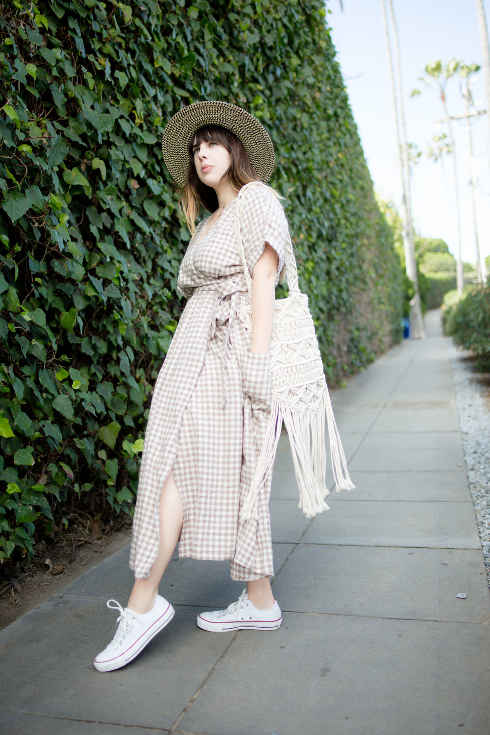b0338346d9 Streetstyle of Girl Wearing UO Gabrielle Linen Midi Wrap Dress and white  converse chuck Taylors