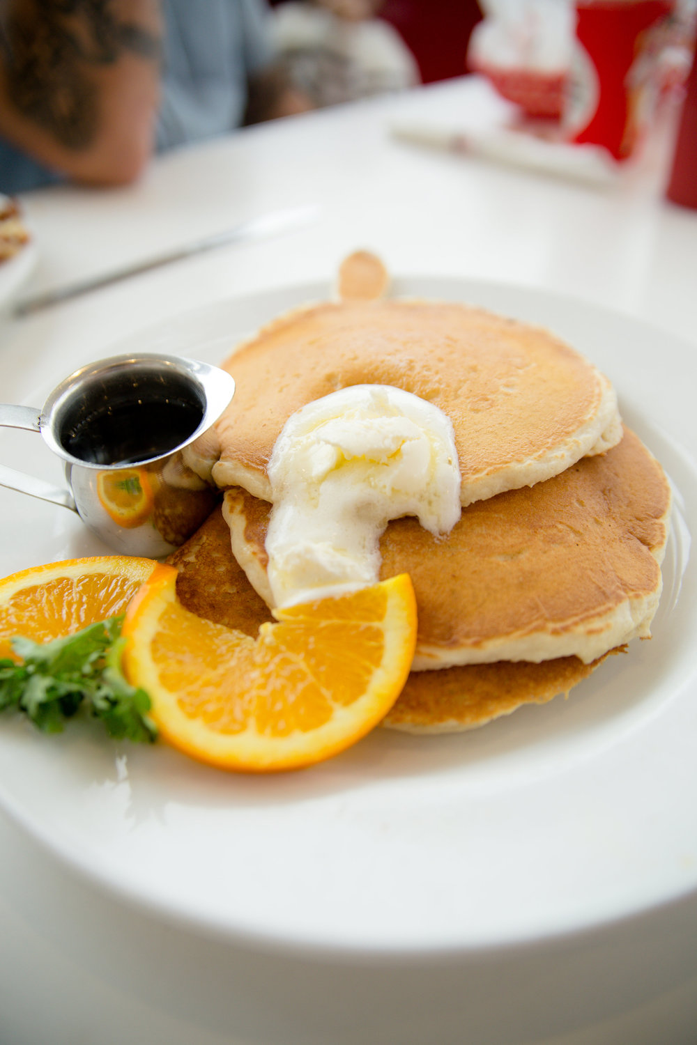 a stack of pancakes from ruby's on the oceanside pier in California