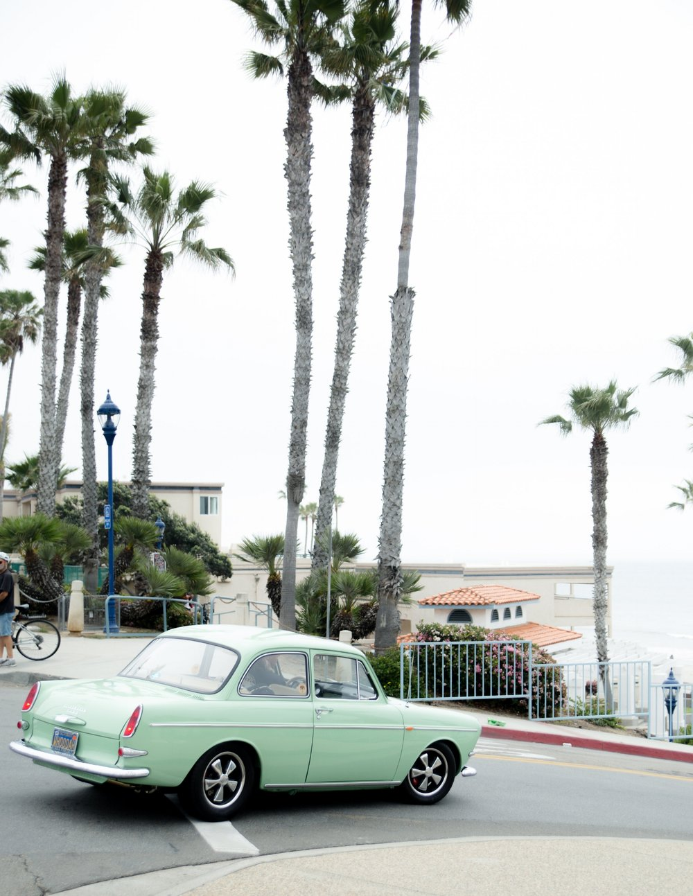 Old car cruising the beach in Oceanside California on a foggy weekend morning