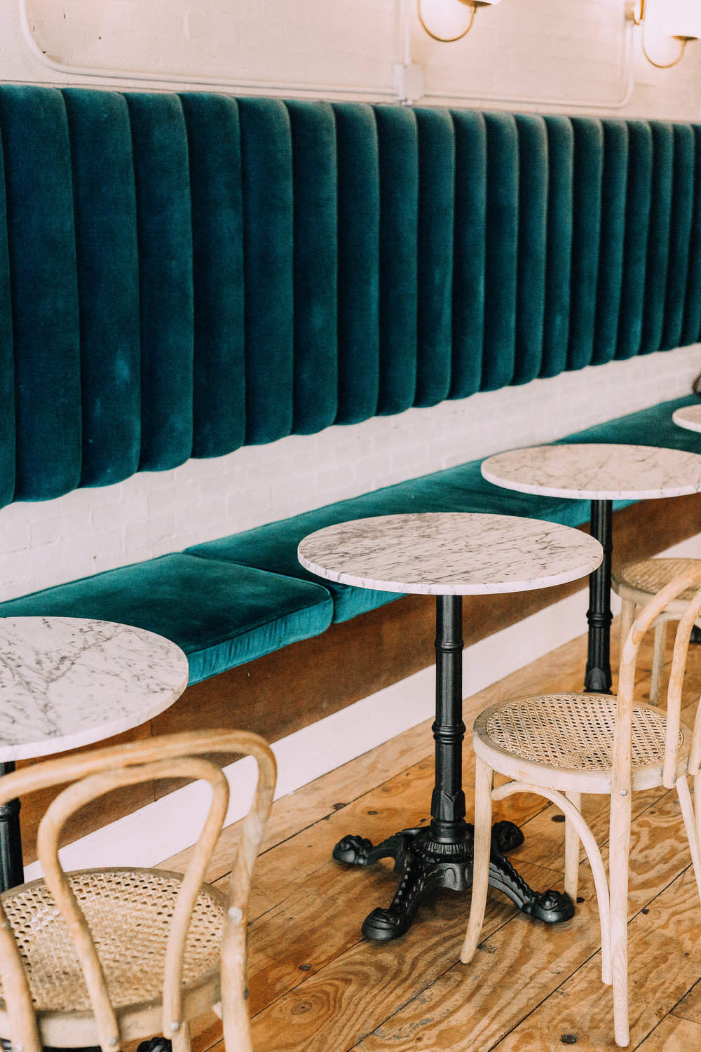 Blue Velvet booth seating, and modern eclectic restaurant interior design at The Goods in Carlsbad Village
