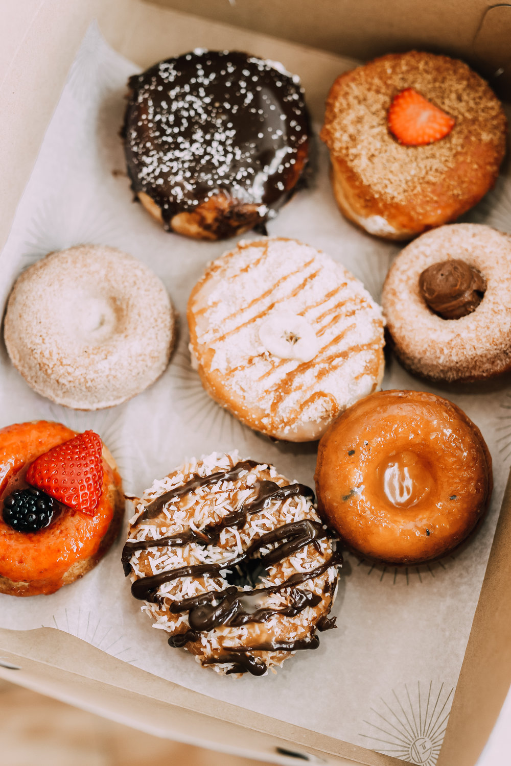 Box of freshly baked delicious gourmet donuts from The Goods in Carlsbad Village
