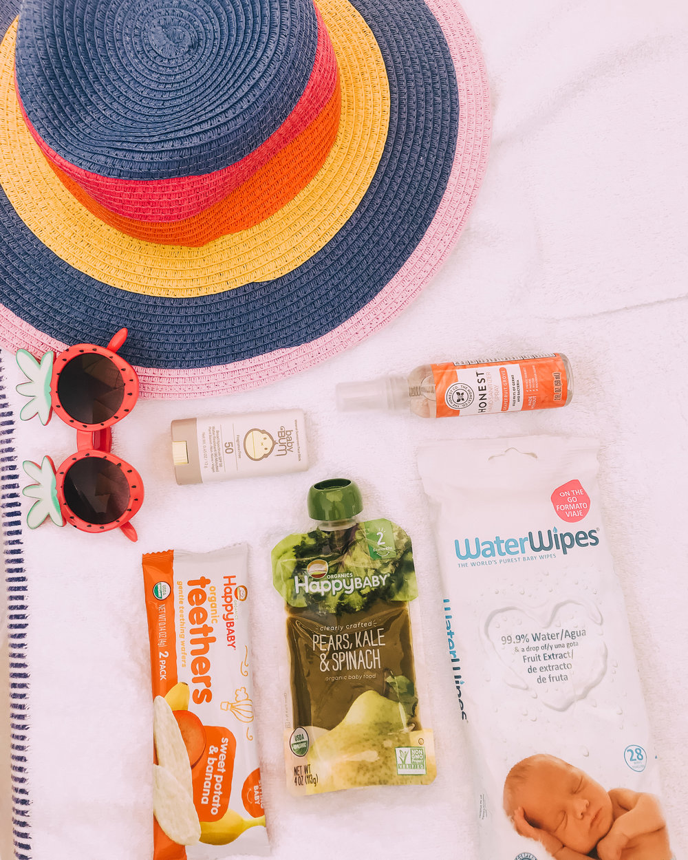 Poolside toddler and baby essentials flat lay
