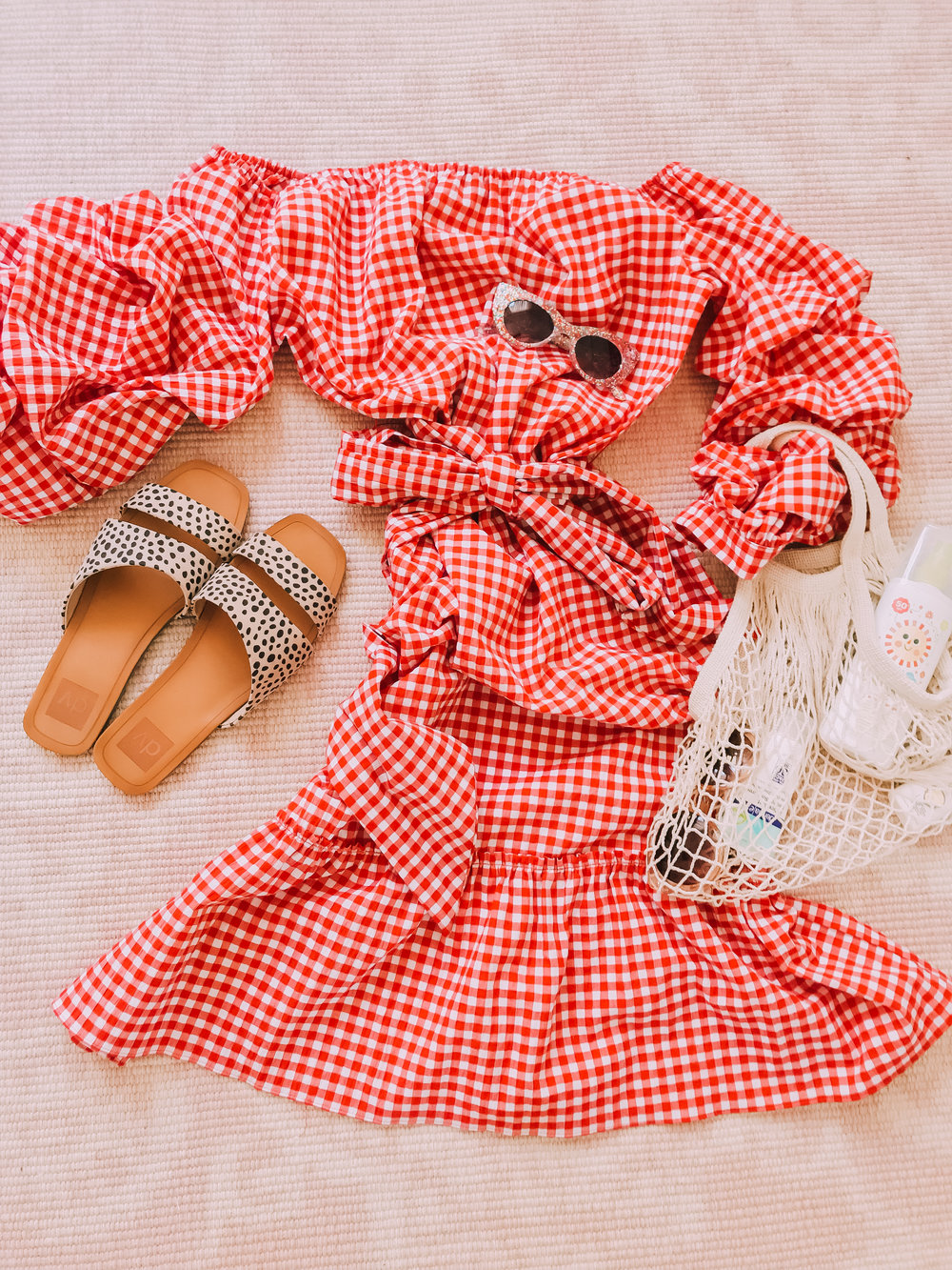 Red Gingam Target off the shoulder Bardot dress with summer accessories flat lay