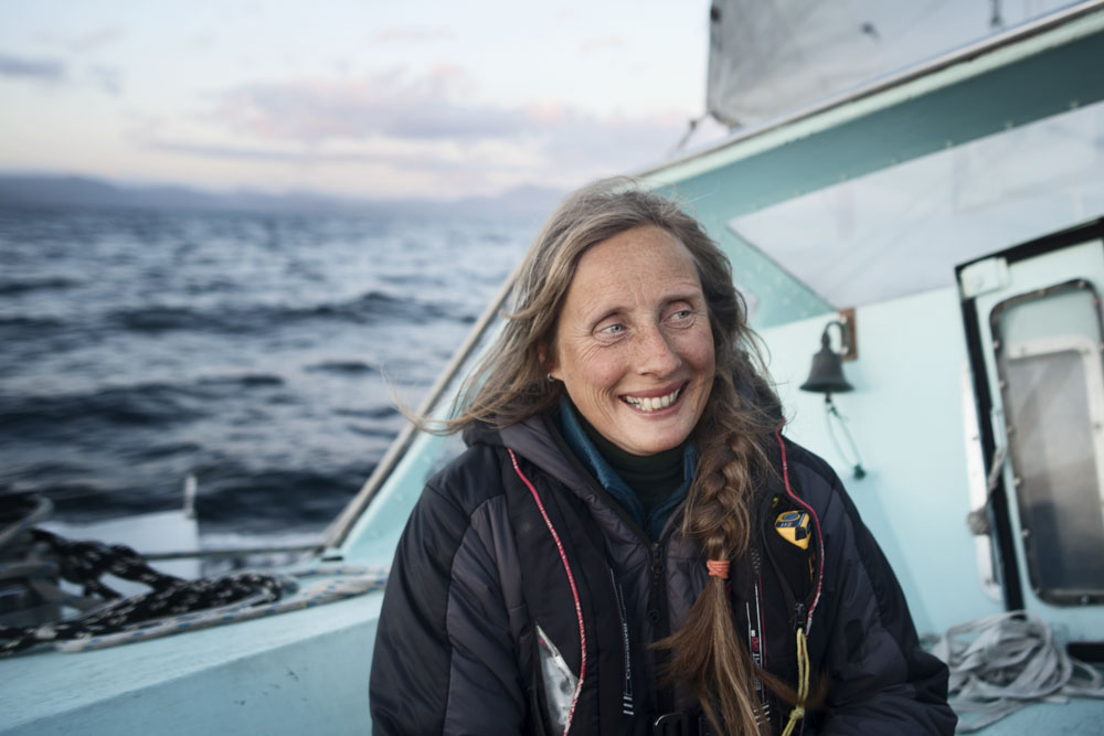 "Our Skipper Celia on her boat ""Selkie"""