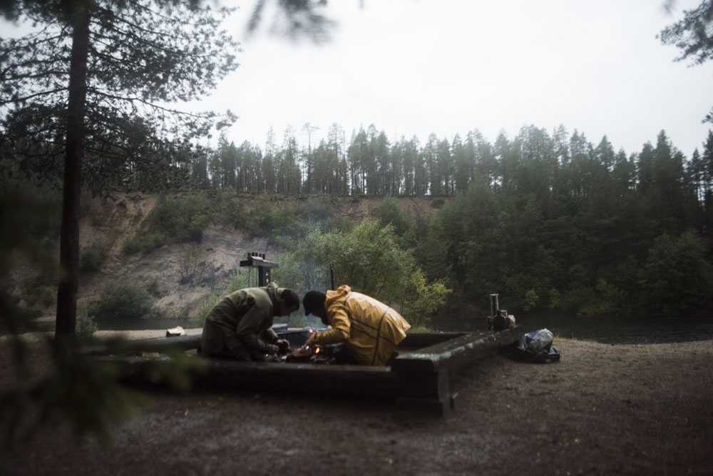 Struggling to light the fire in the wet conditions