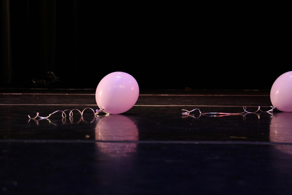 Balloons rest on stage, a sign of the previous night's performance