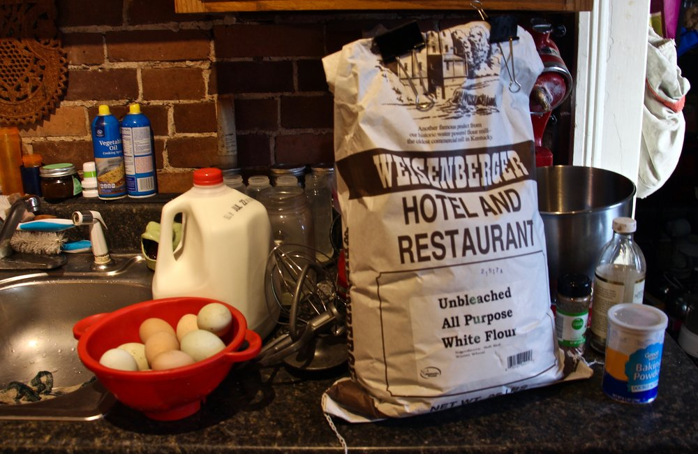 Flour bought in bulk from a local mill and eggs collected from the chickens out back provide the base for the waffle and pancake batter