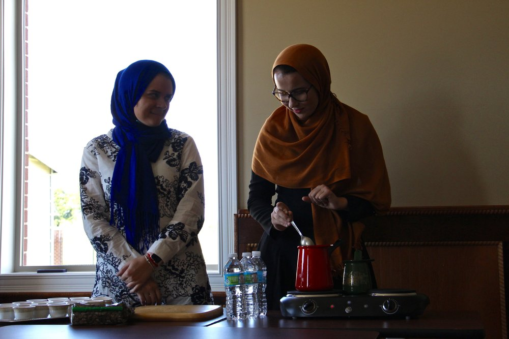 Dzenana (left) and Sanida (right) prepare coffee for RUX members
