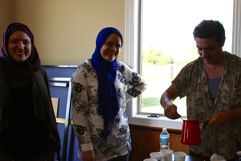RUX member Alex Udis (right) tries preparing a second batch of coffee while KFP staff member Virginia Siegel (left) and Dzenana provide support