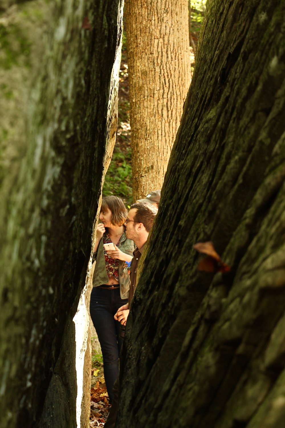 Cara Copper and Tyler McDaniel through the crevice of Split Rock.