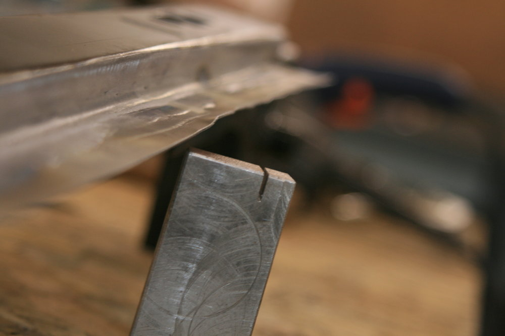 I made a tool to turn up the edge, this took a lot of time and effort bending it just a few mm every time.