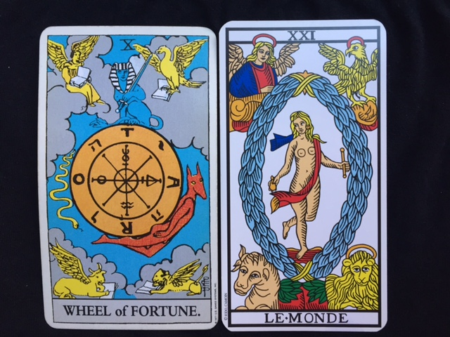 The Wheel of Fortune is from the Rider-Waite-Smith deck, and The World is from the Tarot of Marseilles.
