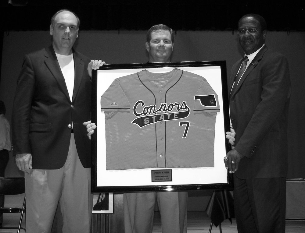 Perry Keith was inducted into the NJCAA Baseball Hall of Fame and had his jersey retired in 2008. Pictured from left to right; Athletic Director Bill Muse, Cowboys Baseball Coach Perry Keith and Connors State College President Dr. Donnie Nero.