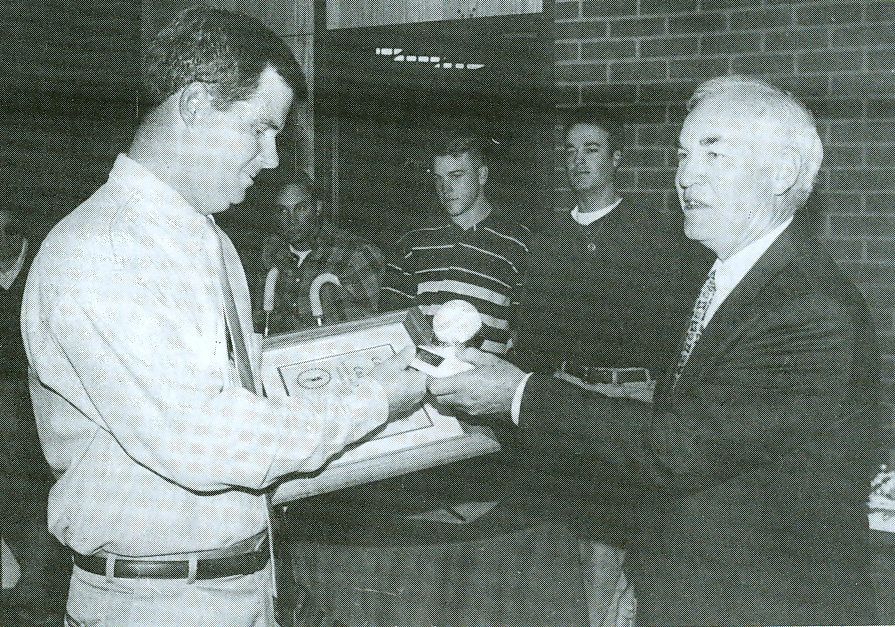 President Garner recognizes Coach Keith for his 600th career win in 1996.