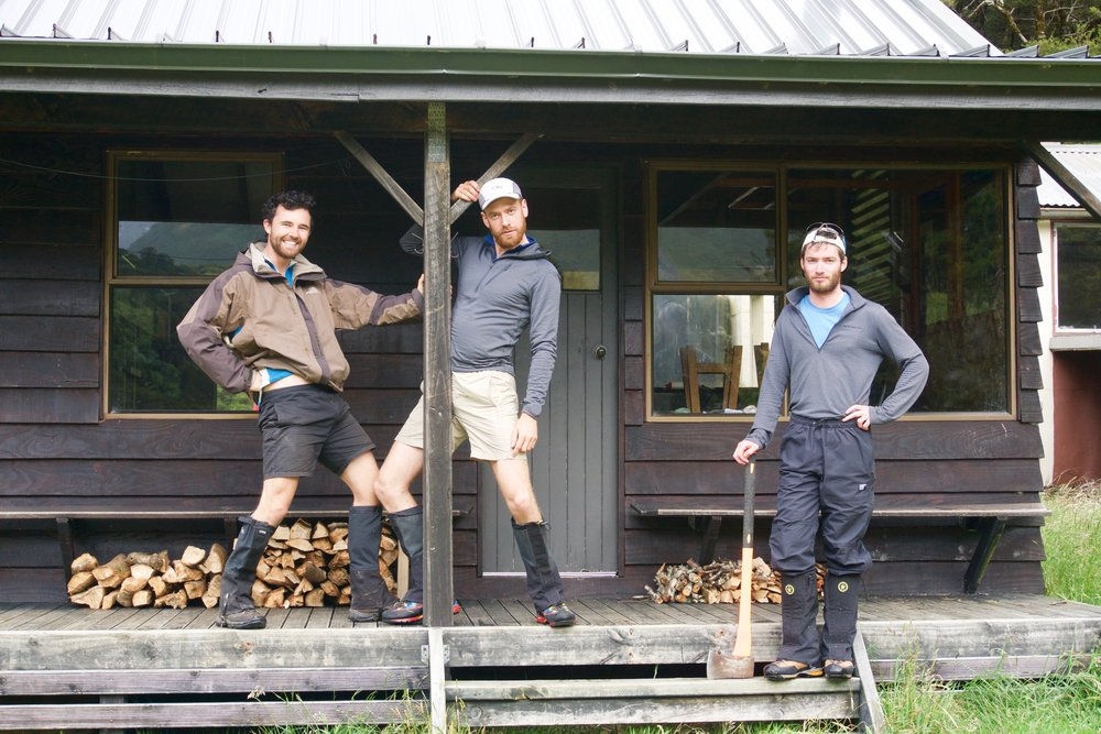 The Goons and The Pioneer: the 'boys' proudly posing in front of the fruits of their labour (the two somewhat pathetic stacks behind them). There was another larger stack at the back of the hut, too, but cutting wood is hard work with blunt tools.