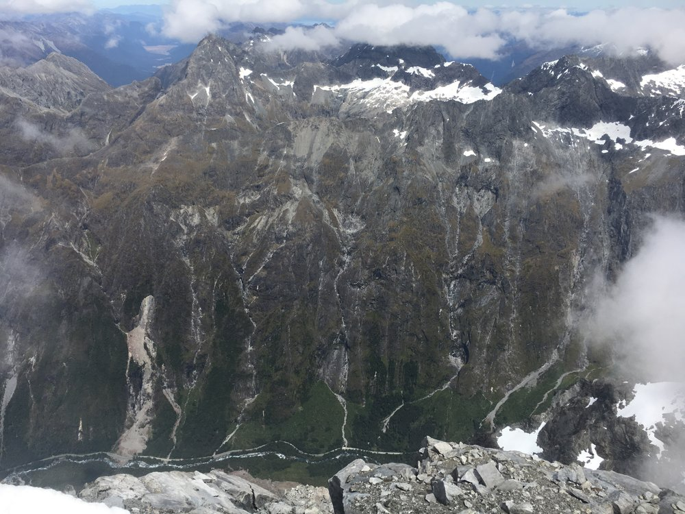 From the summit, looking down to the Milford road and the infant Hollyford River far below.