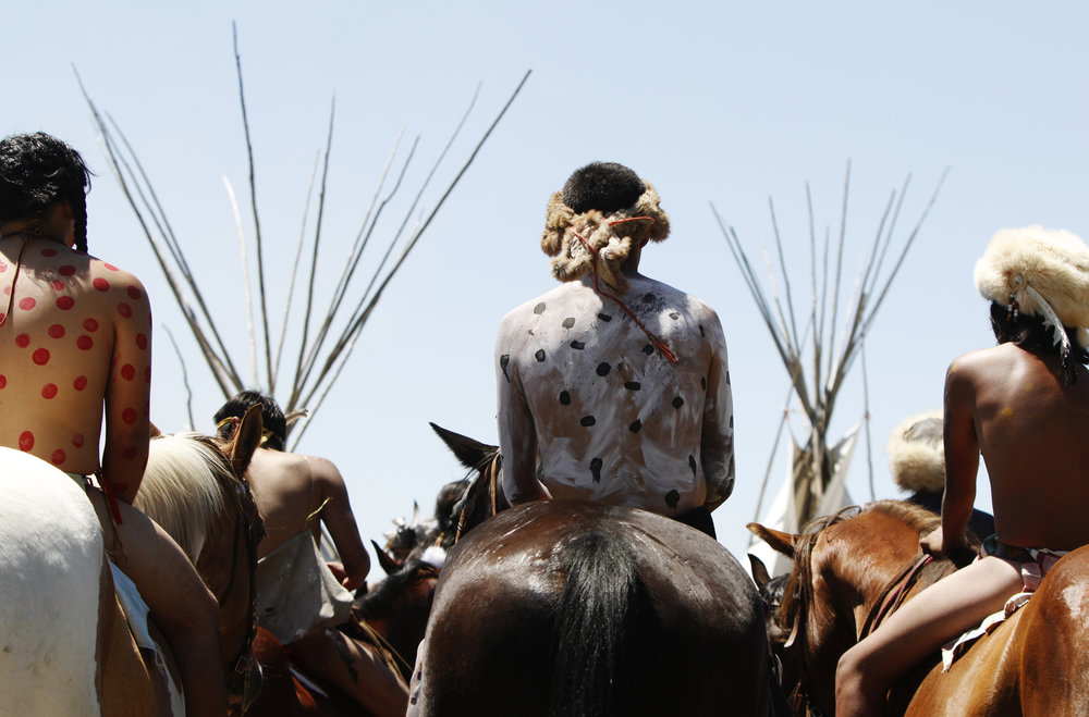 Riders wait for direction after the Battle of the Little Bighorn Re-enactment. The annual battle takes place on the Crow Reservation and the mostly teenage-riders are bareback while they run their horses at high speeds across a river and fields.