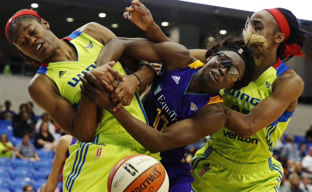 Dallas Wings guard Kaela Davis (10, left) and Dallas Wings forward Glory Johnson (25, right) battle Essence Carson of the Los Angeles Sparks (17, middle) for a loose ball during the second half of a WNBA basketball game between Dallas Wings and the Los Angeles Sparks in Arlington, Texas, Friday, June 9, 2017.(Tailyr Irvine/The Dallas Morning News)