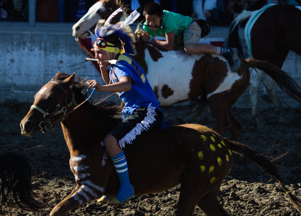 Randey Moccasin races bareback during the All Nations Indian Relay Championships in Billings on September 25, 2016.