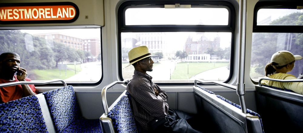 Joshua Miller moves from a bus seat to a train seat on his commute to his appointment in Dallas on Monday, July 03, 2017. Since Josh has no transportation, what would be a 15-minute car commute takes about 2 hours on public transportation. (Tailyr Irvine/The Dallas Morning News)