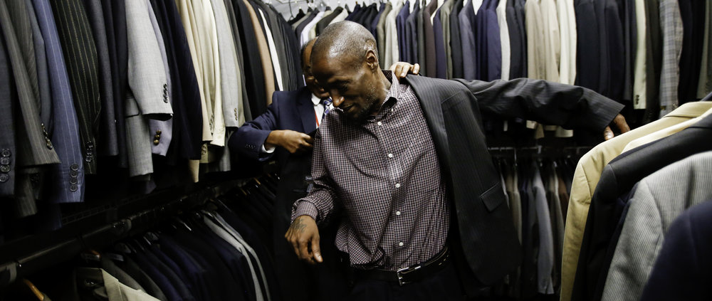 Joshua Miller tries on a suit at Workforce Solutions in Dallas on Monday, July 03, 2017. Miller will use the donated suit for job interviews. (Tailyr Irvine/The Dallas Morning News)