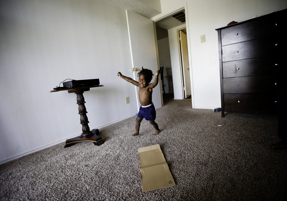 Jordan Miller, 2, runs in circles at his new apartment in Dallas on Saturday, July 22, 2017. His father Joshua Miller said the new space has his son acting like a two-year-old again. Before moving into the one-bedroom apartment, the Millers were living in a small room at the Family First Men's Shelter. (Tailyr Irvine/The Dallas Morning News)