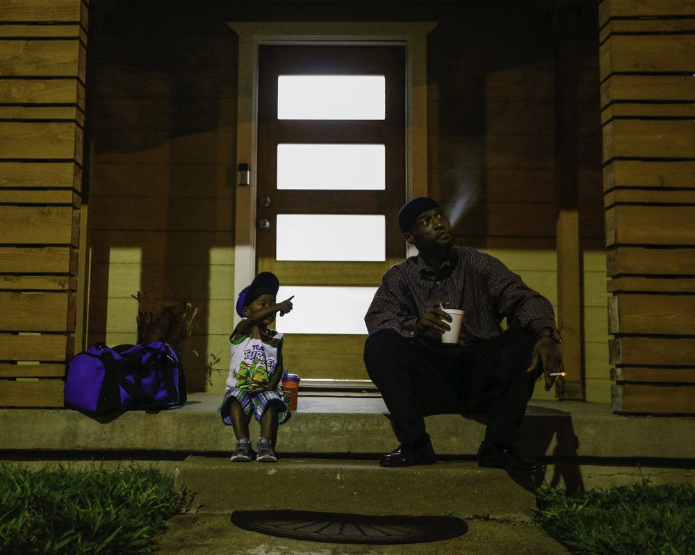 Joshua Miller and his son Jordan wait for the 5 a.m. daycare van to arrive at the Family First Men's Shelter in Dallas on Monday, July 03, 2017. (Tailyr Irvine/The Dallas Morning News)