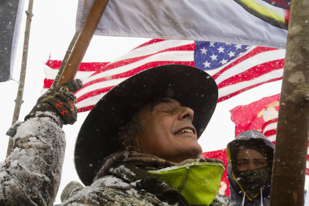 Thousands of veterans and supporters gathered on Highway 1806 near the Oceti Sakowin Camp for the veterans march on December 5, 2016. The group marched to the front lines to pray and dance after the Army Corps decision to evaluate alternative routes for the Dakota Access pipeline.