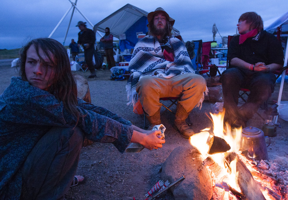 Protesters make a camp along highway 1806 near the DAPL construction site to watch for the possibility of the company working through the night.