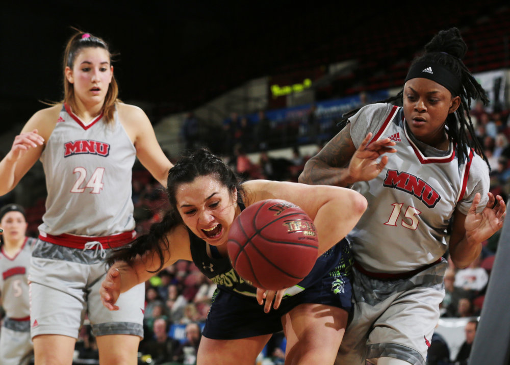 University of Providence's Stephani McDonagh (23) and Nazarene's Alisha Washington (15) chase a loose ball during the second round game of the NAIA national championship basketball tournament at Rimrock Auto Arena at MetraPark on Friday, March 16, 2018.