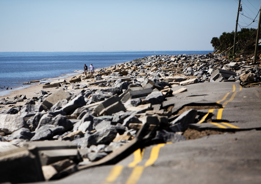 People walk around the destroyed portion of Alligator Drive in Alligator Point on October 12, 2018. Alligator Drive, along with several structures were destroyed in when Hurricane Michael hit the area.