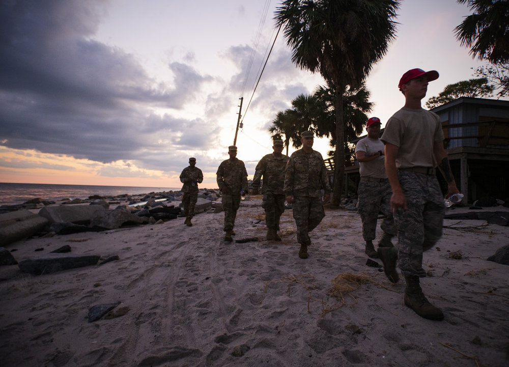 Members of Florida National Guard and the Air Force patrol Alligator Drive in Alligator Point on October 11, 2018, one day after Hurricane Michael hit the area.